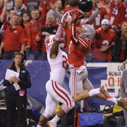 Devin Smith makes an acrobatic touchdown grab with Peniel Jean in coverage