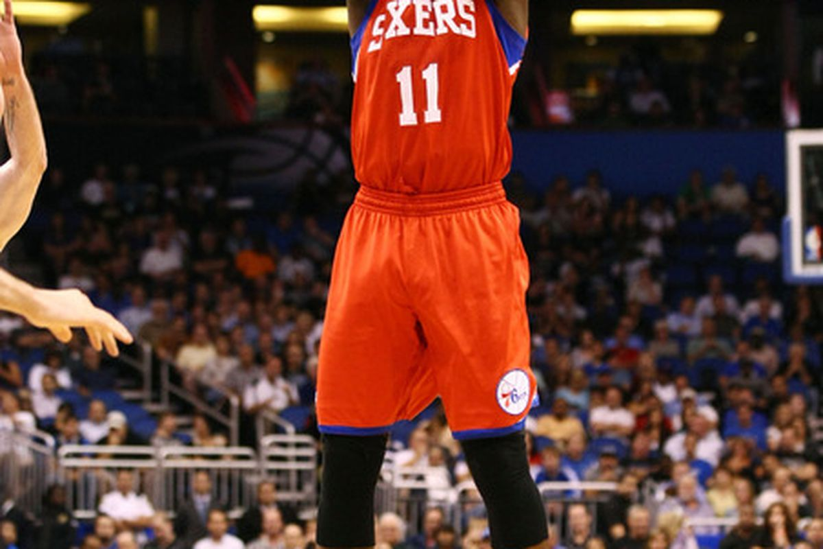 Apr 16, 2012; Orlando, FL, USA; Philadelphia 76ers point guard Jrue Holiday (11) attempts a jump shot against the Orlando Magic during the first quarter at Amway Center. Mandatory Credit: Douglas Jones-US PRESSWIRE