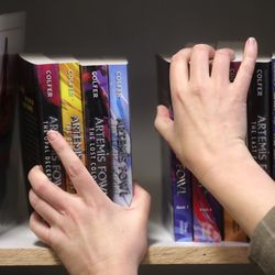 Merrily Cannon, Utah State Library data coordinator, organizes new books at the Odyssey House Adolescent Residential Center in Salt Lake City on Wednesday, Oct. 30, 2019.Staff from the state library division are using a federal grant to redo the library at the center to add age-specific books for the teens in treatment.
