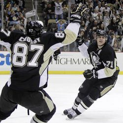 Pittsburgh Penguins' Evgeni Malkin (71) celebrates his 50th goal of the season with teammate Sidney Crosby in the second period of an NHL hockey game against the Philadelphia Flyers in Pittsburgh Saturday, April 7, 2012.
