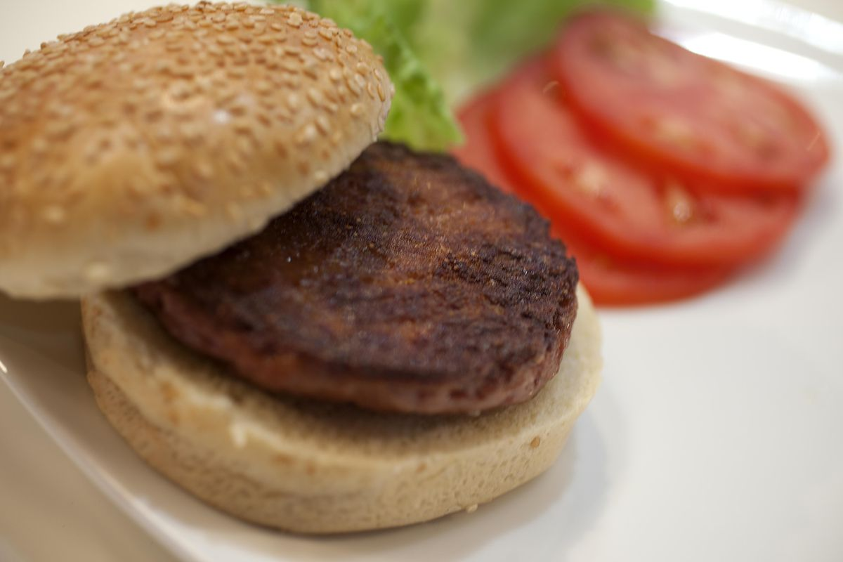 A cooked burger made from cultured beef