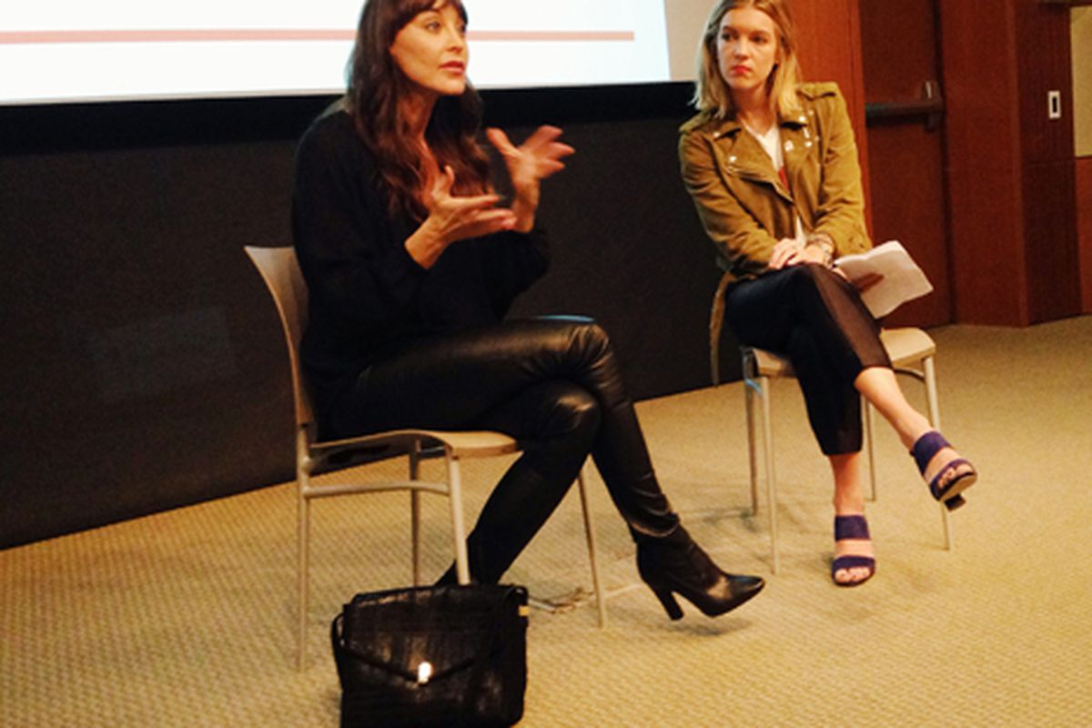 Tamara Mellon (L) wearing her own leather boot leggings, pictured here with Lucky Magazine's Hayley Phelan
