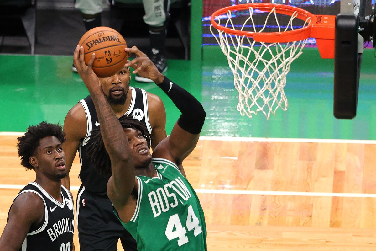 Robert Williams III #44 of the Boston Celtics takes a shot during the preseason game against the Brooklyn Nets at TD Garden on December 18, 2020 in Boston, Massachusetts.