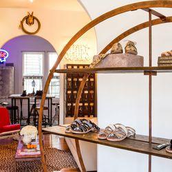 The circular shelving serves up the Spring 2013 collection as you enter.