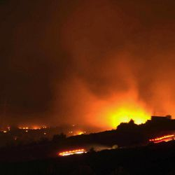 A glow of a large fire seen after an explosion at an ammunition store in Afyonkarahisar in western Turkey which has killed some 25 soldiers and wounded at least four others, Thursday, Sept. 6, 2012. The blast happened on Wednesday night at a military storage for hand grenades in Afyon, military said. Environment Minister Veysel Eroglu said the explosion was most likely caused by an accident and certainly not as a result of terrorism. It is thought many of the soldiers were trapped inside the building as firefighters tackled the huge blaze. (AP Photo) TURKEY OUT