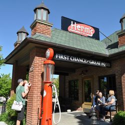 A vintage Mobile gasoline pump stands at the entry way of Herm's Inn in Logan.