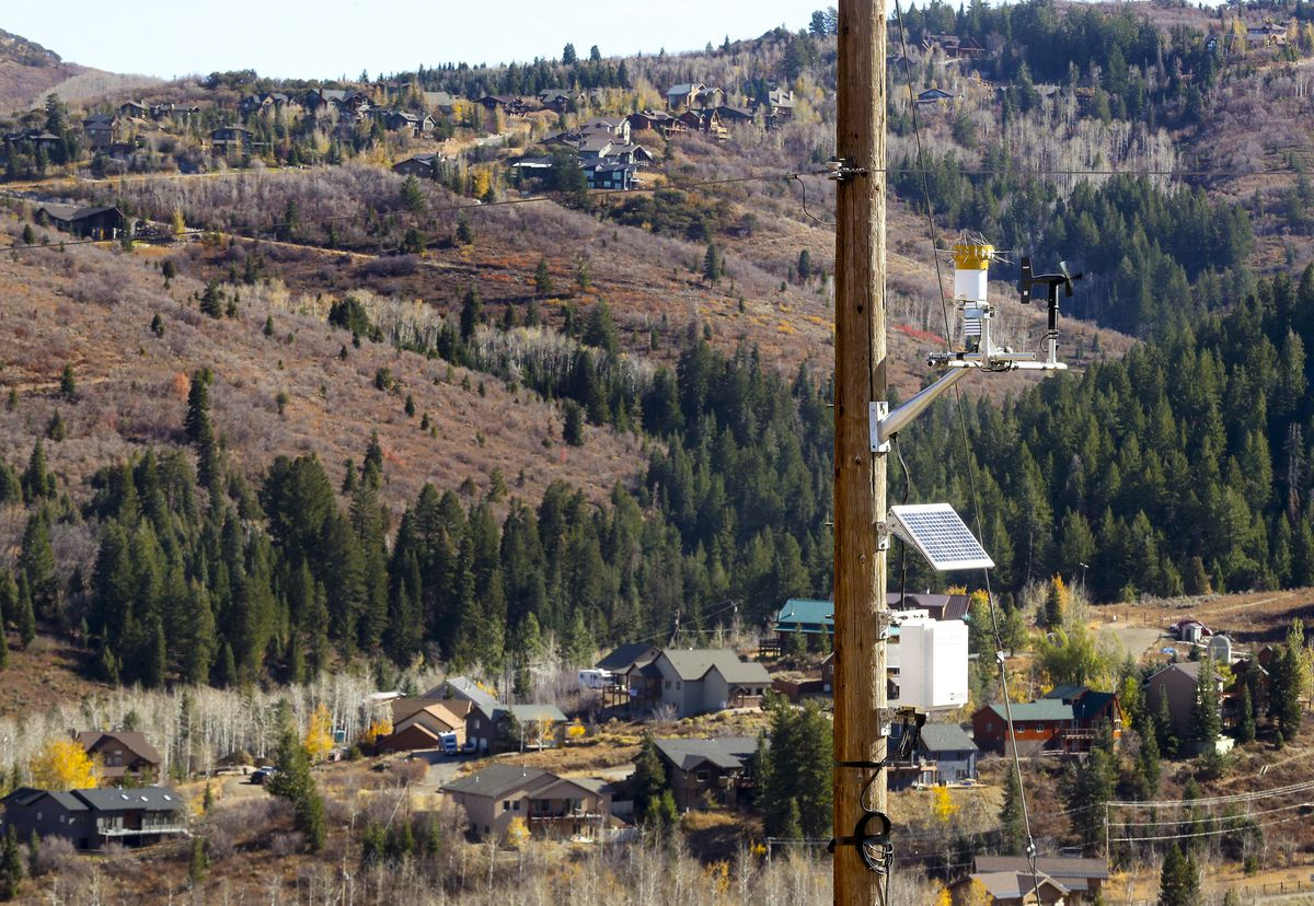 Homes in Summit Park can be seen behind a Rocky Mountain weather station mounted on a power pole in Summit County on Wednesday, Oct. 21, 2020. Rocky Mountain Power may implement power outages in Summit Park and Sundance because of extreme wildfire danger that could be amplified by high winds and super dry conditions. The company is monitoring the situation, which potentially could affect about 1,800 customers.