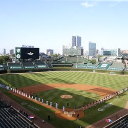 The Brewers and Cubs line up at Wrigley Field before Opening Day, July 24