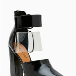 """<a href=""""http://www.nastygal.com/product/strut-cutout-bootie/_/searchString/shoe%20cult"""">Strut Cutout Bootie</a>, $120.00"""