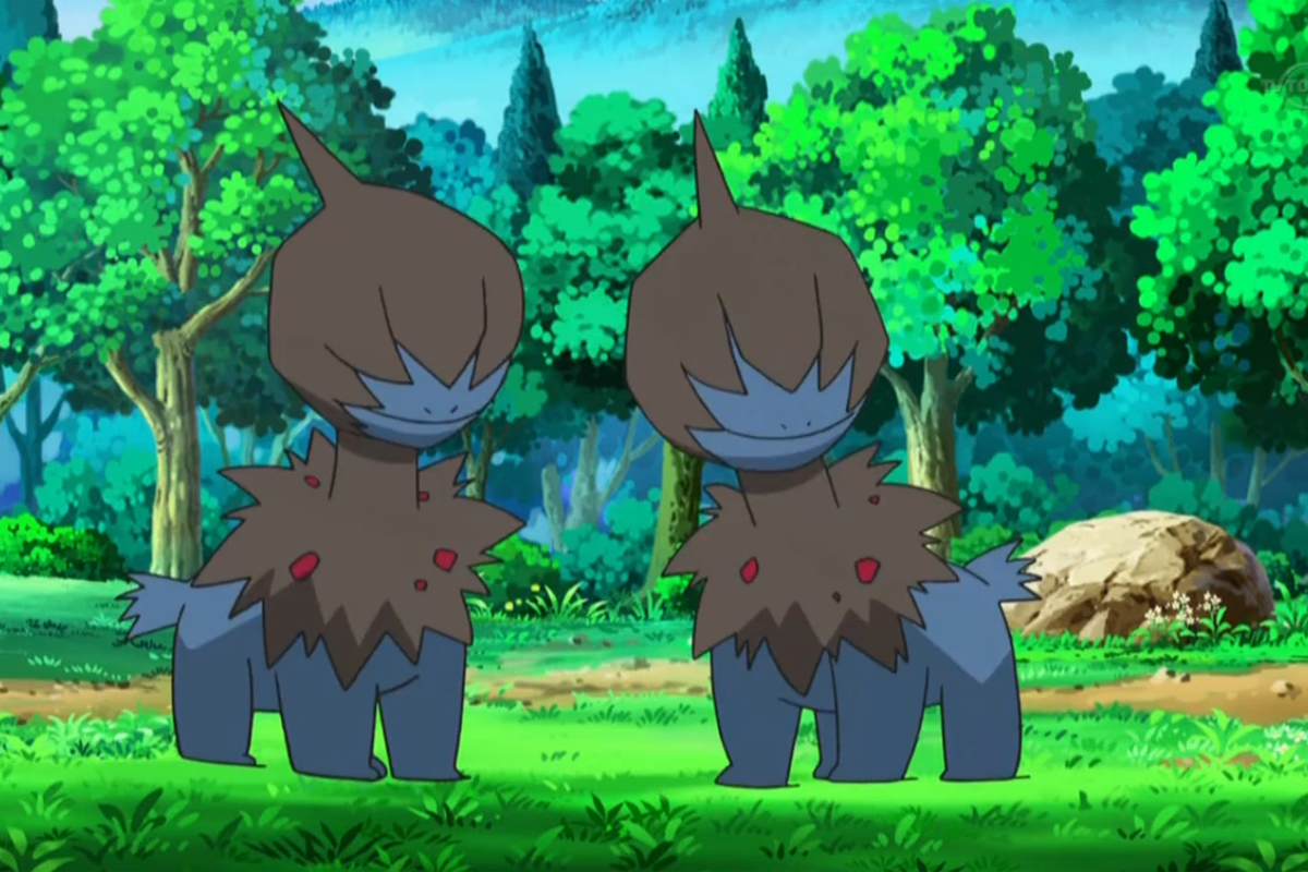 Two Deino hang out in a forest