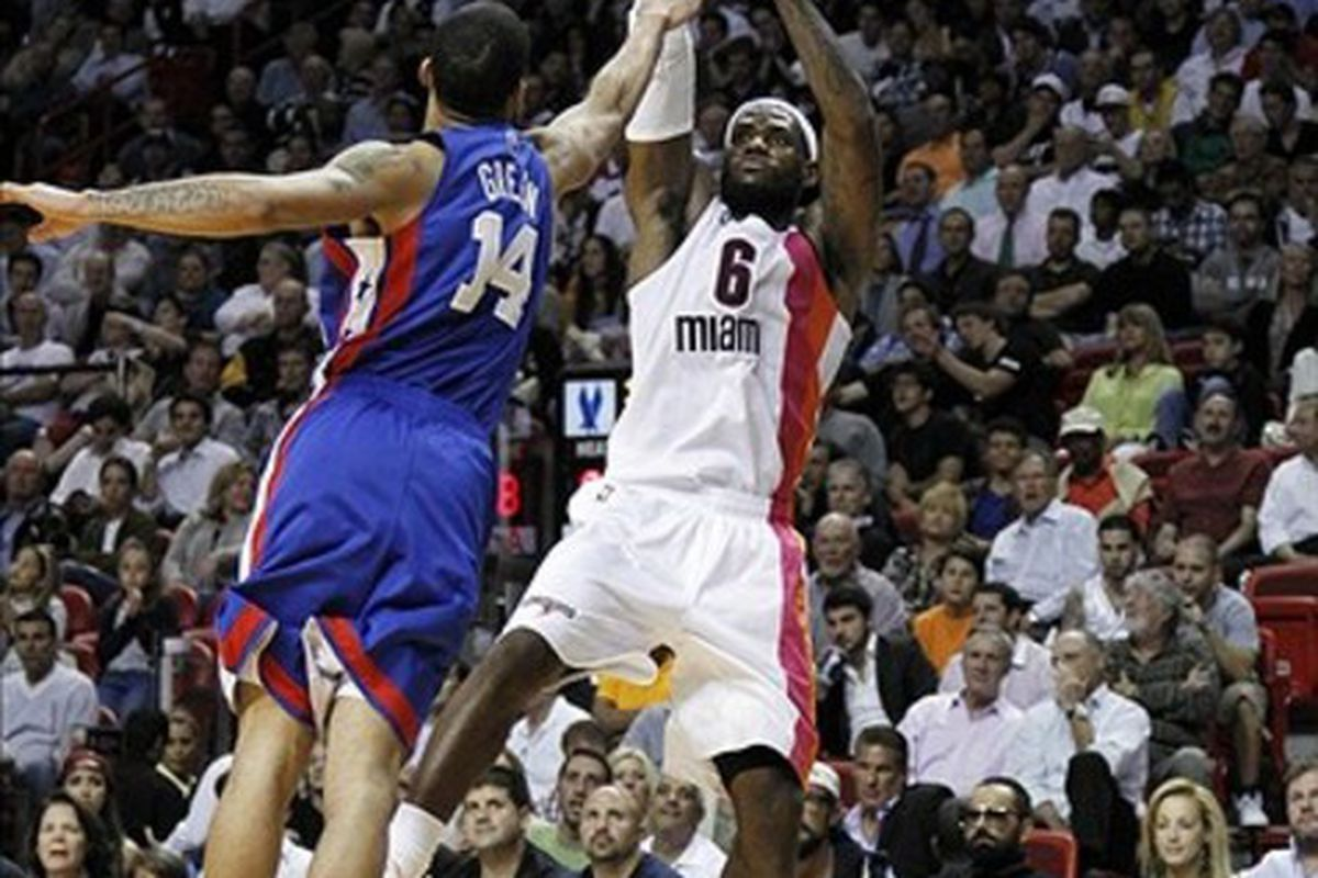 March 6, 2012; Miami, FL, USA; Miami Heat small forward LeBron James (6) makes a basket over New Jersey Nets shooting guard Gerald Green (14) in the third quarter at the American Airlines Arena. Mandatory Credit: Robert Mayer-US PRESSWIRE