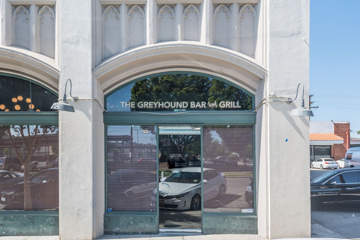 Outside the The Greyhound Glendale with glass doors and arched entrance.