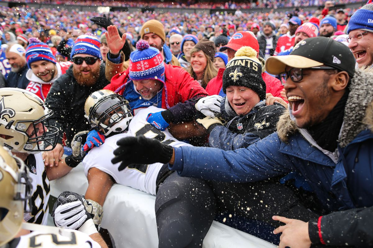 ORCHARD PARK, NY:  New Orleans Saints running back Mark Ingram (22) leaps into the crowd after scoring a touchdown against the Buffalo Bills defense at New Era Field.