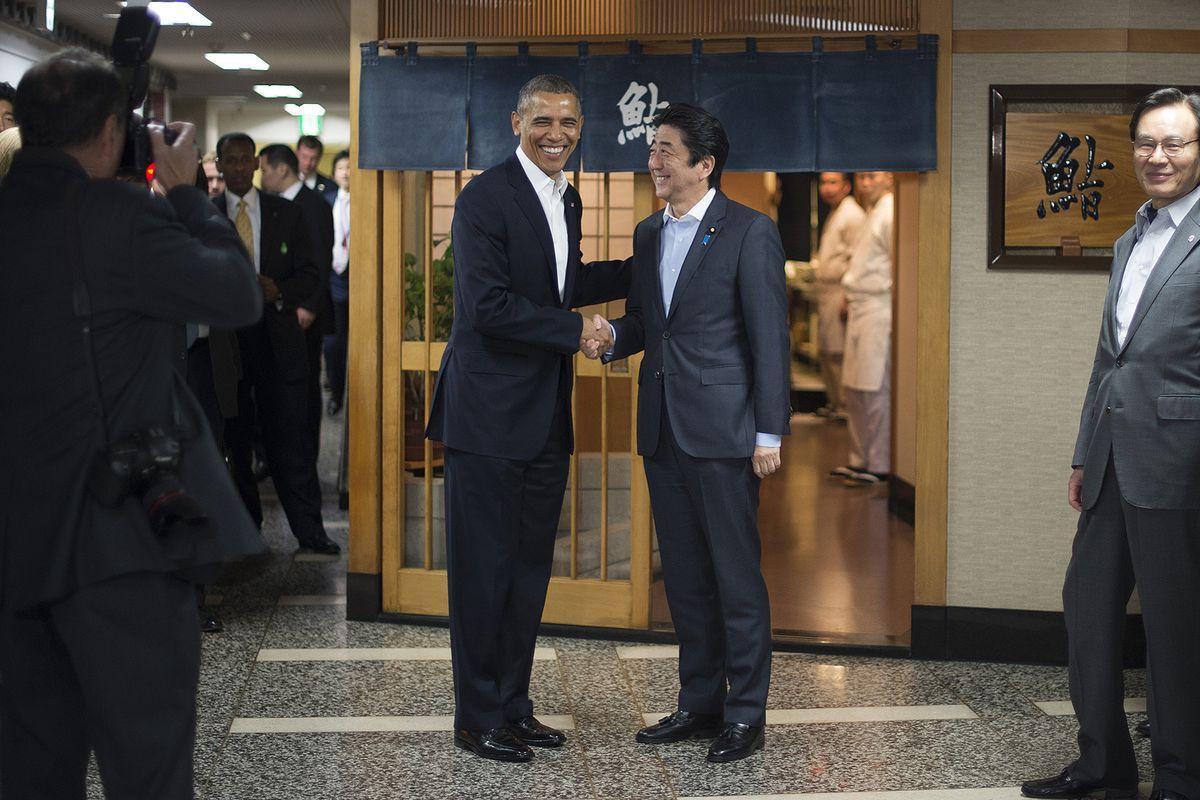 President Barack Obama and Japanese Prime Minister Shinzo Abe outside Sukiyabashi Jiro in Tokyo