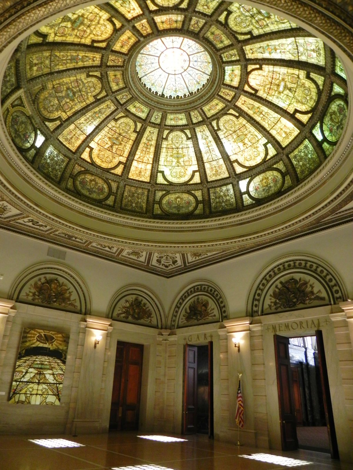 The dome and interiors of the Grand Army of the Republic Memorial Hall and Rotunda of the Chicago Cultural Center were designed by the Tiffany Glass and Decorating Co., a predecessor of the better-known Tiffany Studios.