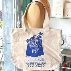 """DeeDee Cheriel """"You Have Everything You Need"""" tote bag, $34 at <a href=""""http://www.hemingwayandpickett.com/deedee-cheriel-bear-you-have-everything-you-need-tote-bag/dp/600"""">Hemingway & Pickett</a>"""