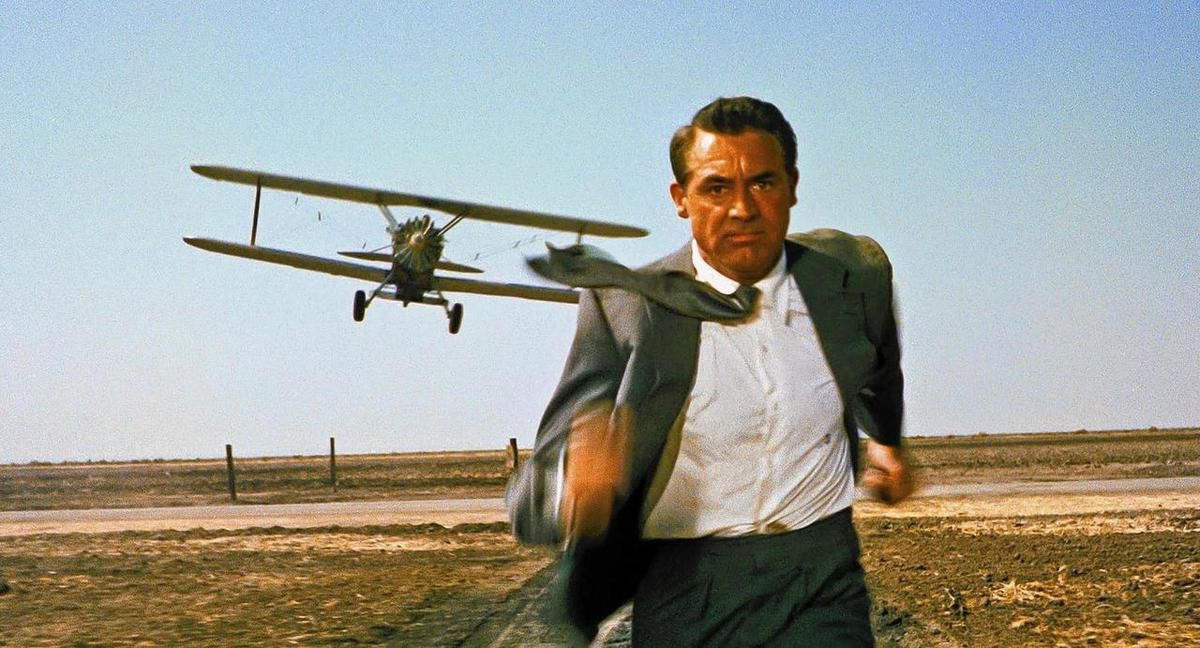"""In this iconic movie image, Cary Grant is pursued by a lethal crop-dusting plane in Alfred Hitchcock's 1959 classic thriller """"North By Northwest,"""" to be shown in selected Megaplex theaters this month."""