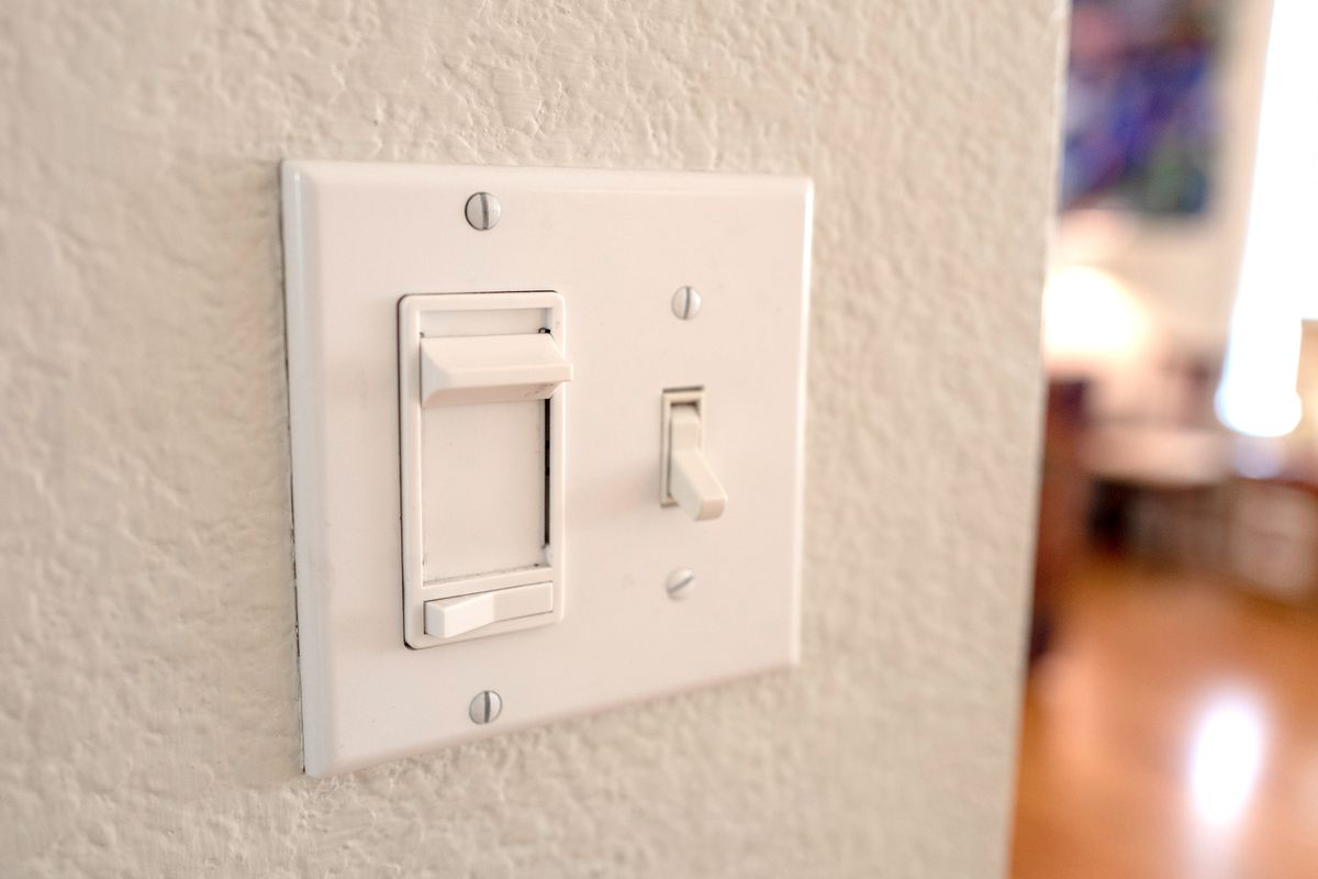 Dimmer and light switch inside home.