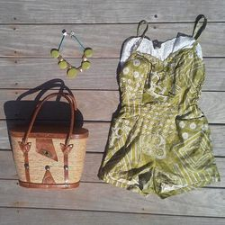 "From <a href=""www.etsy.com/shop/SummerMizeraVintage"">Summer Mizera Vintage</a>: '50s romper, $78; '70s necklace, $78; vintage fisherman's bag, $58"