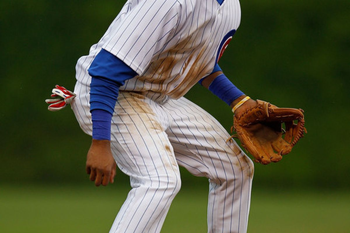 CHICAGO - MAY 12: Starlin Castro #13 of the Chicago Cubs hops into position during a pitch against the Florida Marlins at Wrigley Field on May 12, 2010 in Chicago, Illinois. The Cubs defeated the Marlins 4-3. (Photo by Jonathan Daniel/Getty Images)