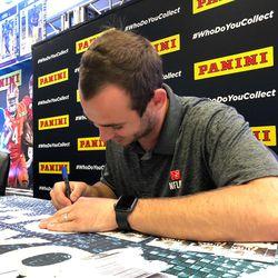 Hunter Renfrow signs football cards