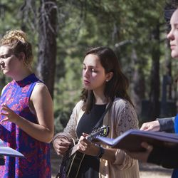 Meleeza Hall, left, Gabi Sheeley and Amy Auble sing worship songs during the 9:30 a.m. nondenominational Christian church service in Bryce Canyon National Park, Sunday, June 18, 2017.