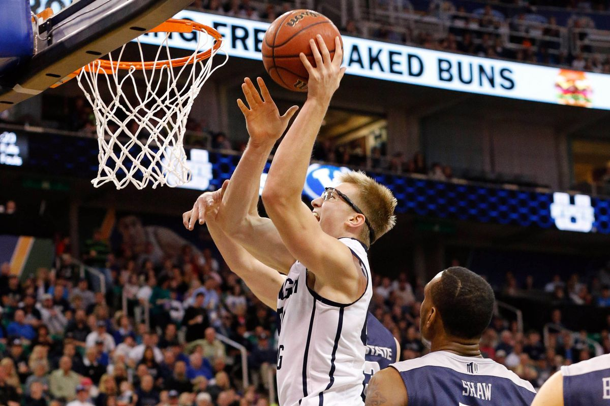 Eric Mika goes up for a basket against USU