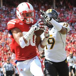 Nebraska's Kenny Bell (80) grabs a touchdown pass in front of Southern Miss's Clifford Johnson (19) during an NCAA football game, Saturday, Sept 1, 2012, in Lincoln, Neb.