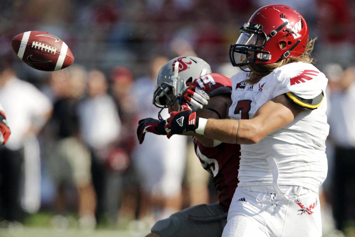 Eastern Washington defensive back Jeff Minnerly, right, breaks up a pass intended for Washington State wide receiver Brett Bartolone during the second half of an NCAA college football game, Saturday, Sept. 8, 2012, at Martin Stadium in Pullman, Wash. Wash