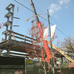 1:55 p.m. Wide view of steel girders being delivered to the right-field video board structure -