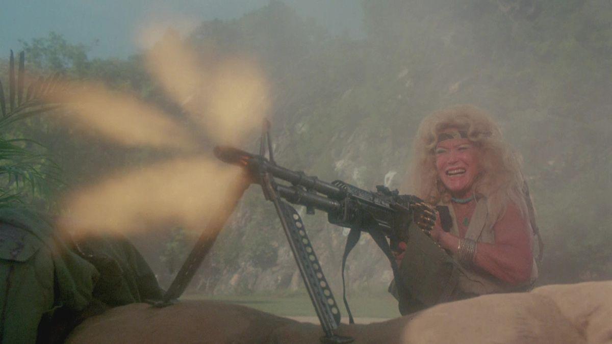 An old lady fires a giant machine gun in Troma's War