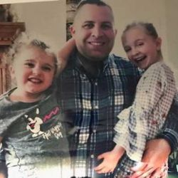 Jerry Ellis holds his two daughters, Kaylee and Zoe. | Provided