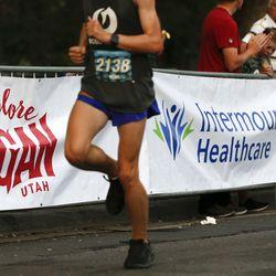 Sponsors' signage is pictured during the Deseret News Marathon in Salt Lake City on Friday, July 23, 2021.