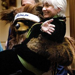 Utah Sen. Pat Jones, who has season tickets for Jazz games, is lifted by the Jazz Bear on Monday.