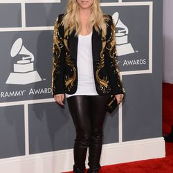 Kaley Cuoco went casual in leather pants, an Amen blazer and a Stark clutch.
