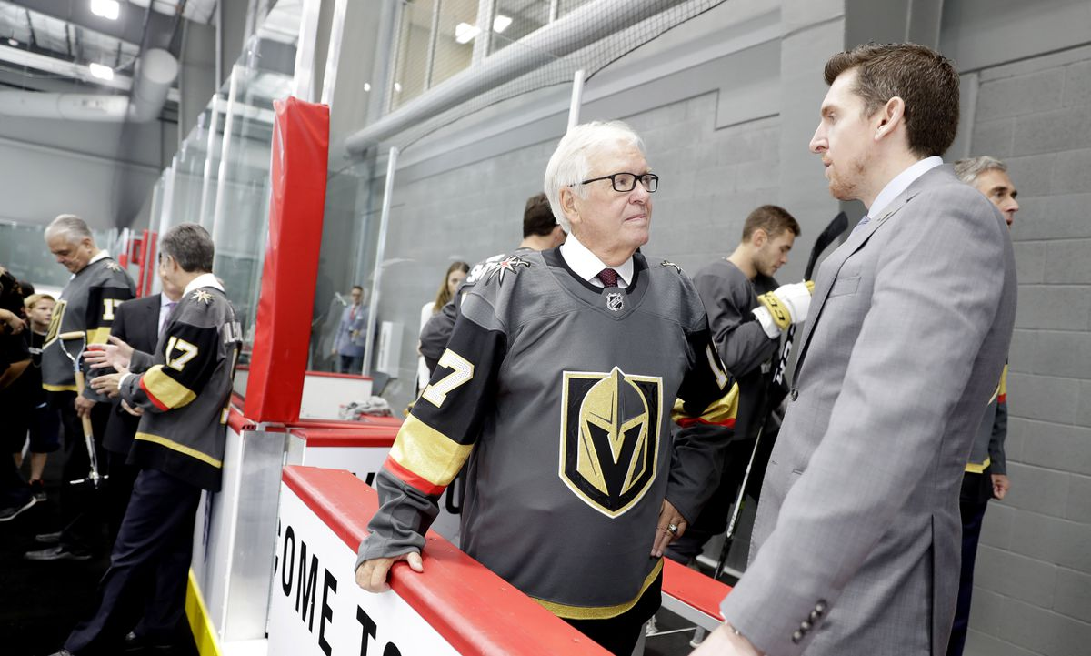 Team owner Bill Foley speaks to a man in a suit at the opening of the Golden Knights' practice facility.