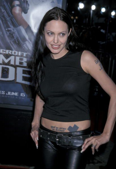 Angelina Jolie wearing a black crop top and jeans