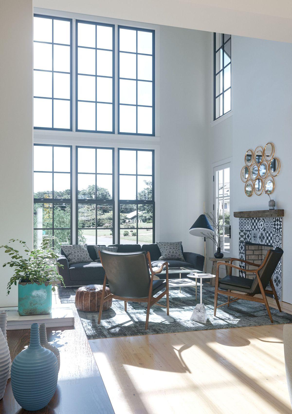 Huge windows in a living room.