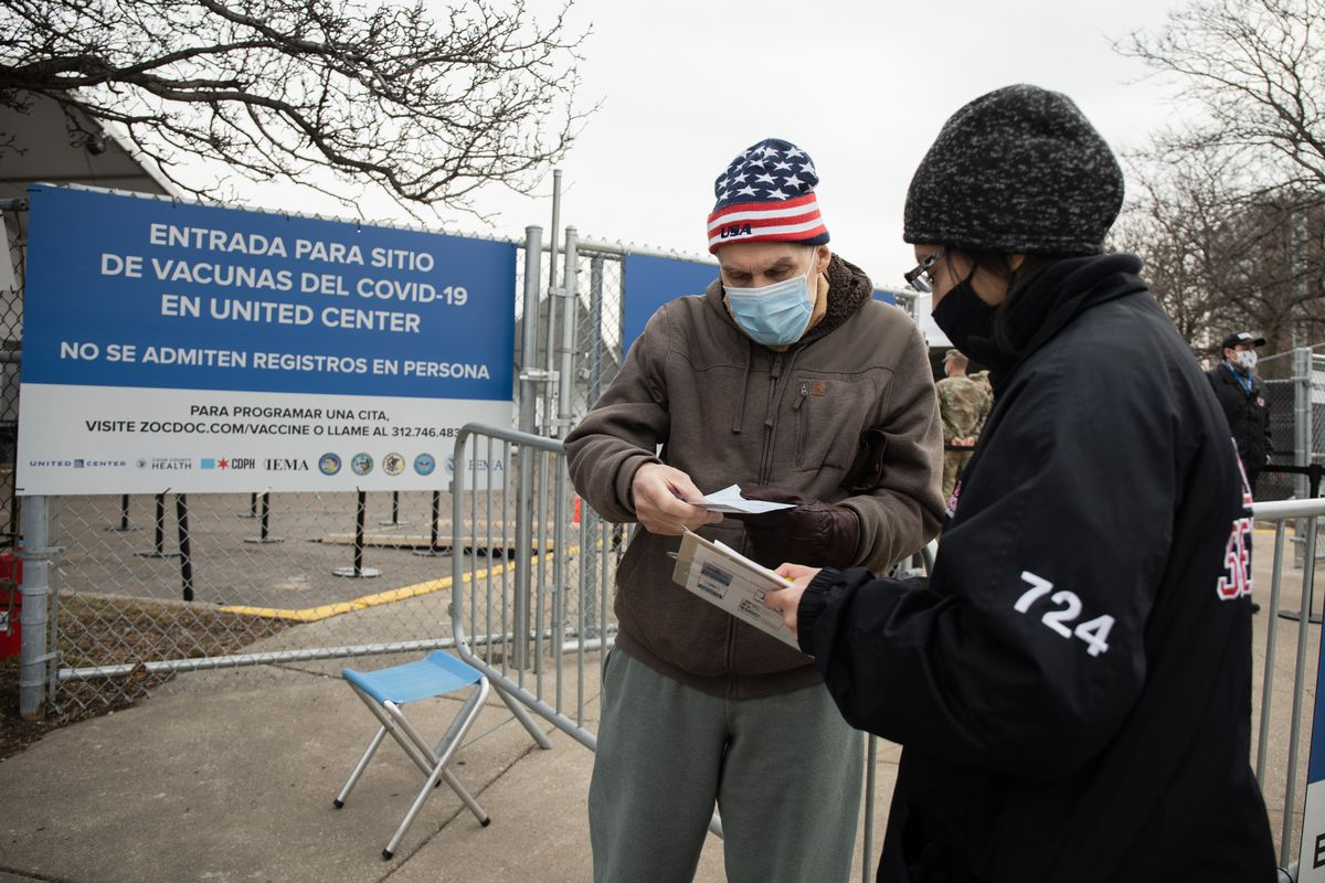 A man arrives for an appointment Tuesday at the COVID-19 mass vaccination site set up on the parking lot of the United Center.