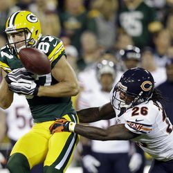 Chicago Bears cornerback Tim Jennings (26) breaks up a pass intended for Green Bay Packers wide receiver Jordy Nelson (87) during the first half of an NFL football game Thursday, Sept. 13, 2012, in Green Bay, Wis.