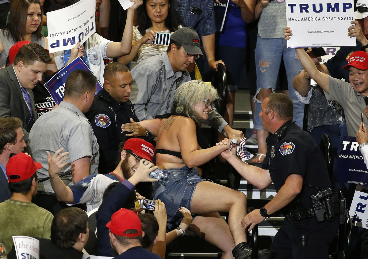 A protester is removed during Donald Trump's speech Tuesday at a rally in Albuquerque, New Mexico.   Brennan Linsley/AP