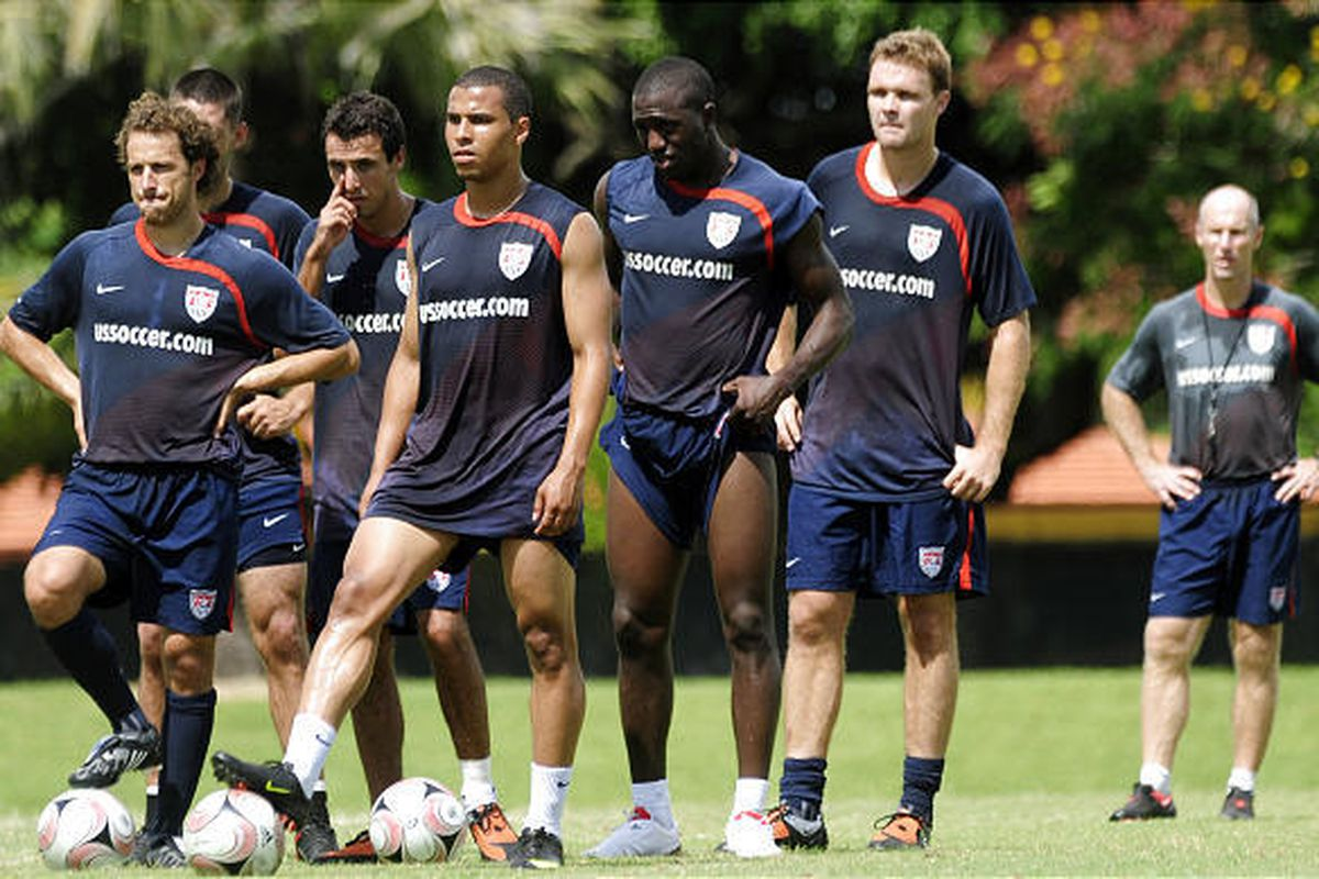 Members of the United States men's national soccer team wait during a shooting drill as coach Bob Bradley, right, looks on, during a training session Tuesday at Barry University in Miami Shores, Fla. The team faces Mexico on Wednesday in Mexico City in a