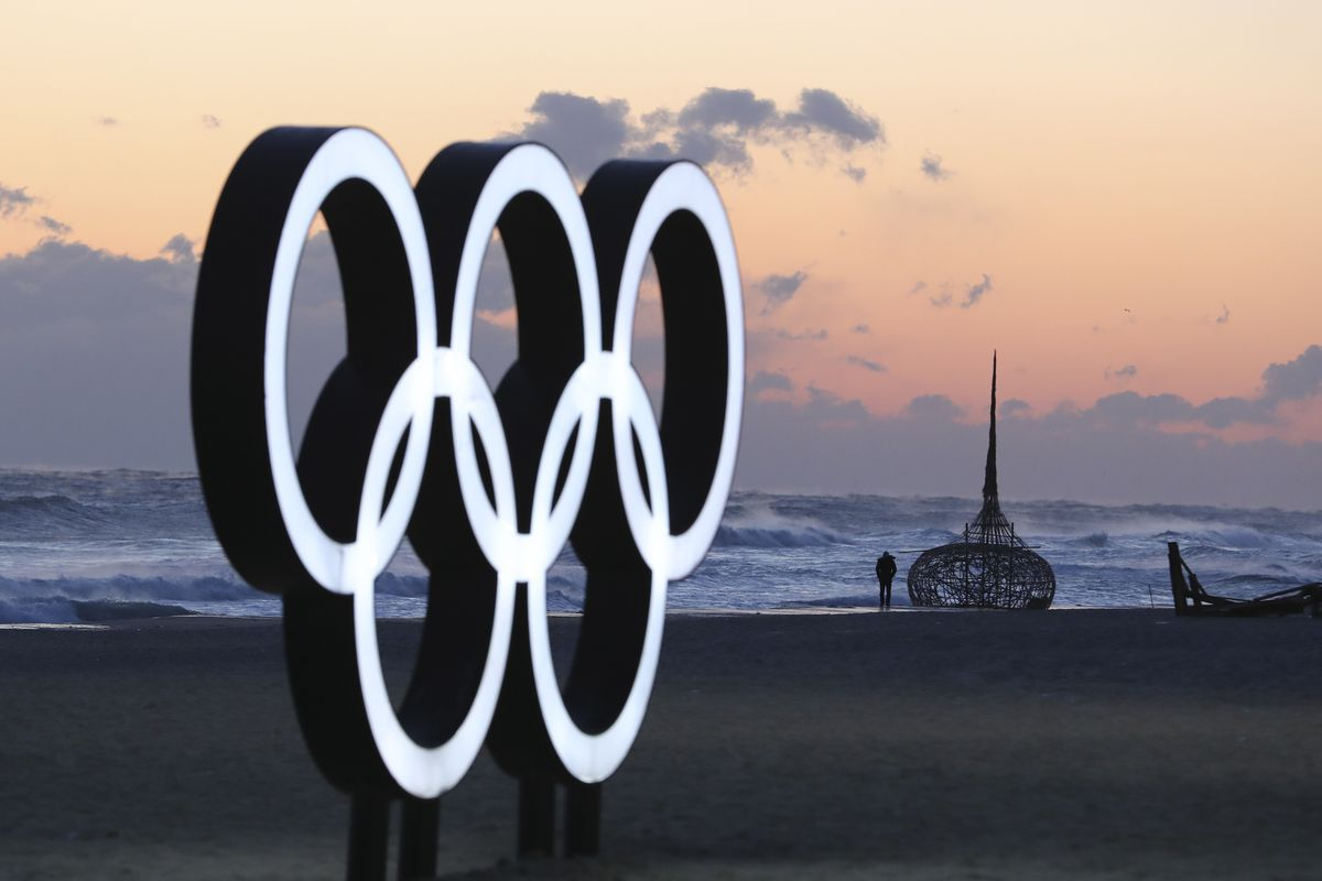 A visitor walks along the beach near the Olympic Rings in Gangneung, South Korea, Wednesday, Jan. 24, 2018. Gangneung is the site of the coastal cluster which will host ice hockey, figure skating, speedskating, short track and curling for the 2018 Olympic