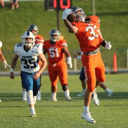 Skyridge's Josh Davis (33) makes a catch for a first down against Fremont in Lehi on Thursday, Aug. 12, 2021.
