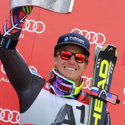 Ted Ligety, of the United States celebrates on the podium after winning an alpine ski, men's World Cup giant slalom, in Soelden, Austria, Sunday, Oct. 27, 2013. Ted Ligety maintained his dominance in giant slalom by taking the season-opening World Cup race by a 0.79-second winning margin Sunday, while Bode Miller finished 19th upon his return to the circuit following a 20-month injury layoff. (AP Photo/Giovanni Auletta)