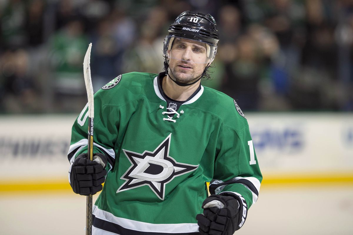 Even Patrick Sharp stands up a little straighter around his dad.
