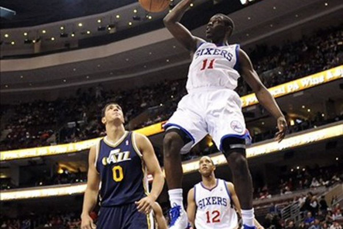 Mar 09, 2012; Philadelphia, PA, USA; Philadelphia 76ers guard Jrue Holiday (11) dunks during the fourth quarter against the Utah Jazz at the Wells Fargo Center. The Sixers defeated the Jazz 104-91. Mandatory Credit: Howard Smith-US PRESSWIRE