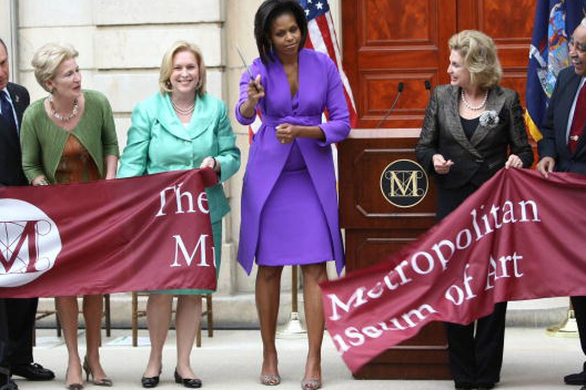 Michelle Obama at the ribbon cutting for the American Wing At Metropolitan Museum Of Art in 2009, image via Getty