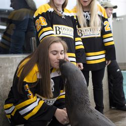 Boston Blades forward Courtney Turner gets a kiss from Ursula.