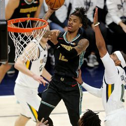 Memphis Grizzlies guard Ja Morant (12) pushes up a shot as the Utah Jazz and the Memphis Grizzlies play in game one of their NBA playoff series at Vivint Arena in Salt Lake City on Sunday, May 23, 2021. Memphis won 112-109.